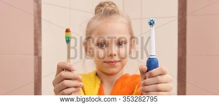 Young Girl Choice Toothbrush. Bamboo Or Electric Tooth Brush. Morning Dental Care Routine. Bathroom