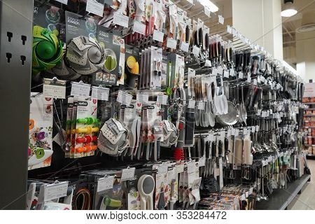 Kitchen Tools Hanging In Shop. Large Set And Variety Of Different Manufacturers On Shelves In Store.
