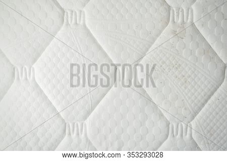 Mould On A Mattress. Black Stains On A White Fabric.