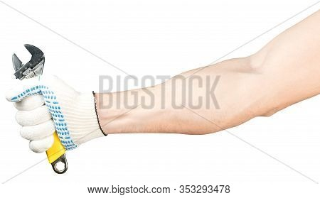 A Male Hand In A Working Glove Holds An Adjustable Wrench. Worker S Hand Isolated