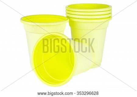 Standing And Lying Unused Green Disposable Cups Made Of Biodegradable Materials Isolated On White Ba