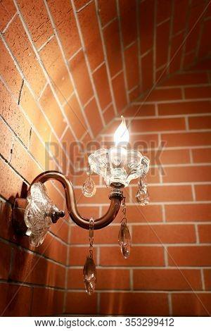 Lighting Lamp On Brick Wall