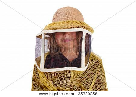 Cute smiling child wearing big yellow beekeeper's hat