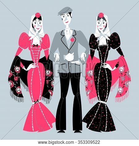 Man And Two Women In Traditional Clothes During The Festival Of