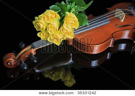 Violin and yellow roses
