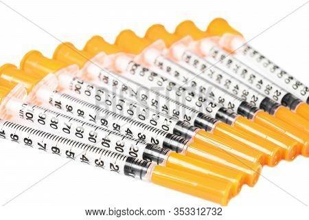 Pile Of Insulin Syringe For Diabetes Isolated On White Background. Close-up Empty Syringe Isolated I