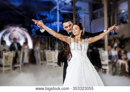 Beautiful Bride And Handsome Groom Dancing First Dance At The Wedding Party.