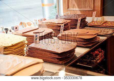 Vienna, Austria - February 19, 2020: Handmade Swiss Chocolate Bars Behind The Store Window Of A Pati