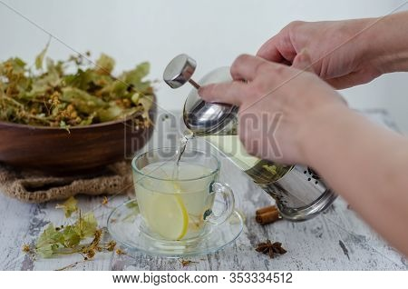 Linden And Linden Tea. Herbal Tea Made From Linden. Detox Herbal Tea On Wooden Table.the Woman Is Po
