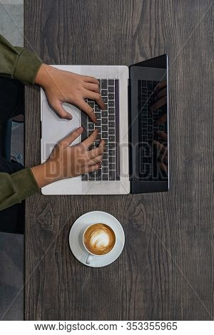 Vertical Photo Of Human Hands Typing Laptop Keyboard At Coffeeshop
