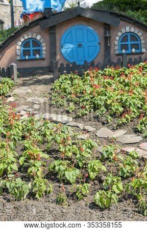 Kiev, Ukraine. Juny 20 2019 The Little Hobbit House. Themed Flowerbed In The Park. Vertical Photo