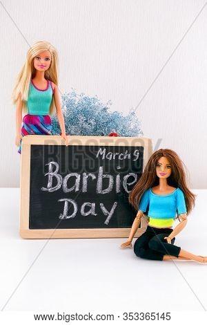 Tambov, Russian Federation - February 24, 2020 Two Barbie Dolls Near Blackboard With Words Barbie Da