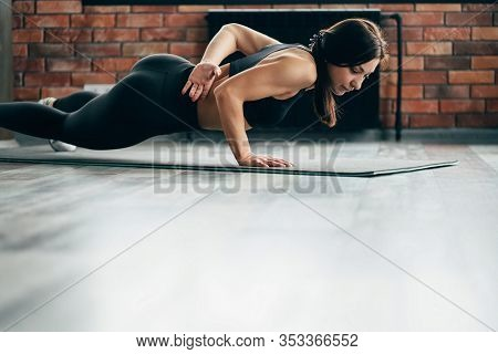 Fitness, Power, Strength And Endurance. Fit Muscular Woman Exercising At The Gym, Doing One Hand Pus