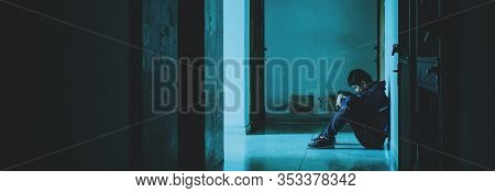 Silhouette Of Man Sitting Alone,sad And Serious Man Sitting Hug His Knee Alone Of Close Condo., Dram