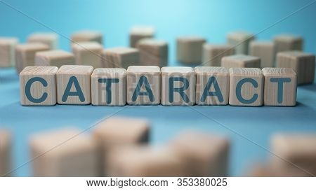 Cataract Word From Wooden Blocks On Blue Background