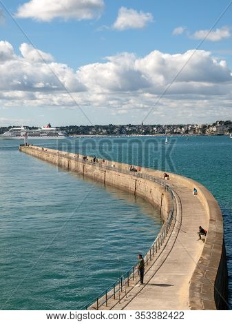 St Malo, France - September 14, 2018: View From The Ramparts At The Pier Mole Des Noire,  Lighthouse