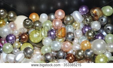 Colored Pearls Close-up. Pearl Beads Round Background.blue, Purple, Green And Pink Beads Texture.