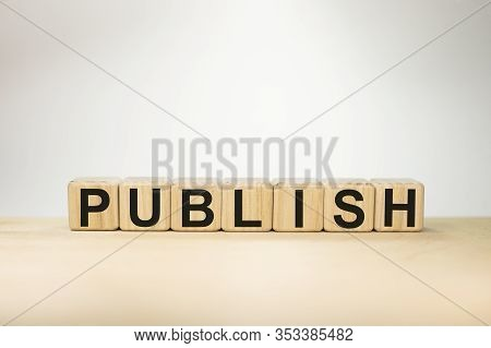 Word Publish On Wooden Cubes On White Background
