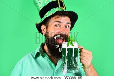St. Patricks Day. Happy Irish Leprechaun Drinks Green Beer. Irish Tradition. Bearded Man In Leprecha