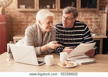 Retirement Financial Planning Concept. Happy Senior Couple Discussing Family Budget Together, Sittin