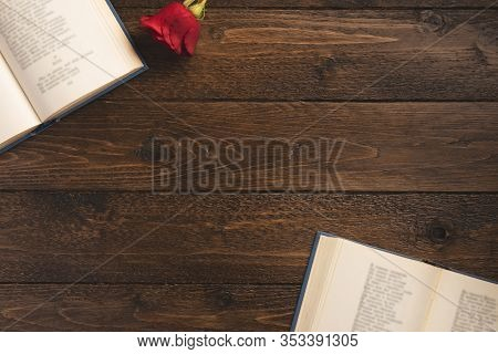 Romantic Concept. Open Books With Poems And Rose, On Wooden Background. Flat Lay, Top View, Copy Spa