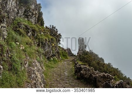 Old Mountain Rural Trail In The Mountains Of The Island . Evening Clouds And Fog Crawling On The Woo