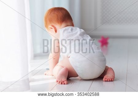 Cute Little Infant Baby Girl Crawling Around The House At Sunny Day