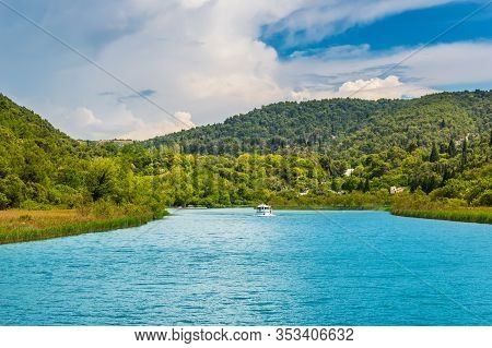Green Hills With Forest Around Krka River In Beautiful Krka National Park, Croatia. Touristic Boats