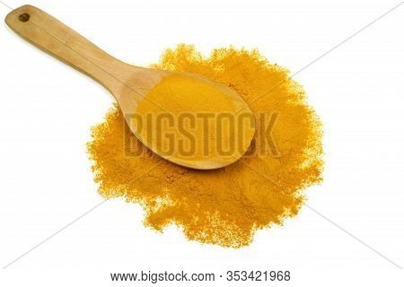 Turmeric Powder In A Wooden Spoon Or (curcumin) Which Is Isolated On A White Background As An Ingred