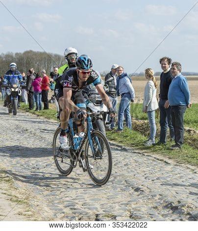 Gruson, France - April 12,2015: The English  Cyclist, Ian Stannard  Of Team Sky, Riding During Paris
