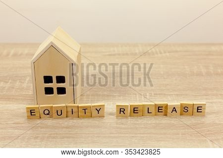 The Words Equity Release In Front Of A Small Wodden House