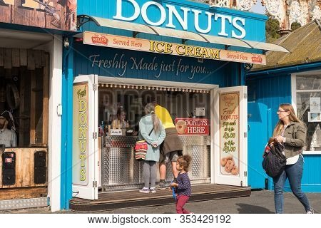 Llandudno, North Wales, Uk. September 10, 2019. People Buying Freshly Made Donuts, From Outdoor Stal