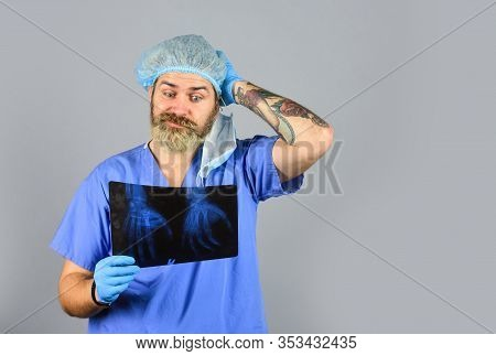 Nurse Checking X-ray Film At Hospital. Health Problems. Surgery Operation And Medical Concept. Man L