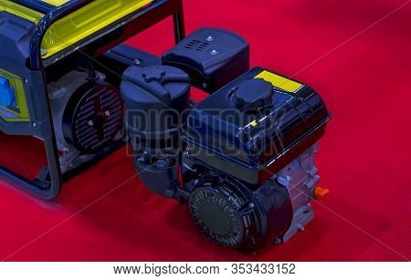 Gasoline Portable Generator On The House Construction Site. Close Up On Mobile Backup Generator .sta
