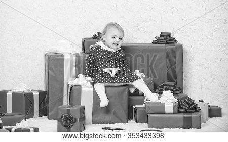 Baby First Christmas Once In Lifetime Event. Family Holiday. Little Baby Girl Play Near Pile Of Gift