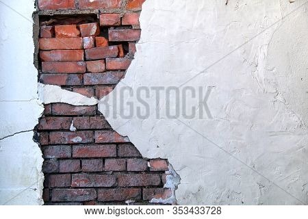 A Beautiful White Stucco Painted Wall With Exposed Natural Vintage Red Bricks