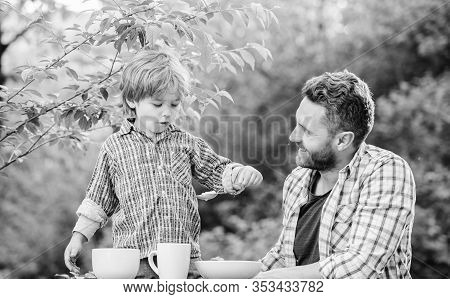 Father Teach Son Eat Natural Food. Little Boy And Dad Eat. Organic Nutrition. Healthy Nutrition Conc