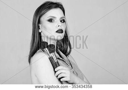 Makeup Dark Lips. Attractive Woman Applying Makeup Brush. Professional Makeup Supplies. Makeup Artis