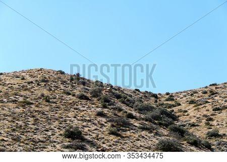 A Sunny Blue Sky And Mountain Top Ridge