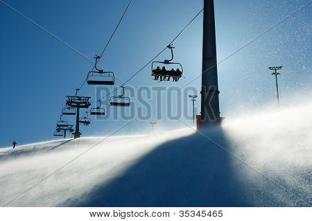Backlit Scenes With Ski Lift Chairs