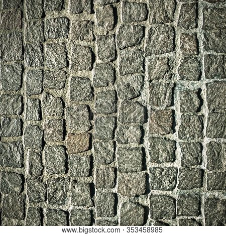 Cobblestone Pavement Texture Background. Detail Of Granite Sidewalk. Top View Of Stone Road. Square