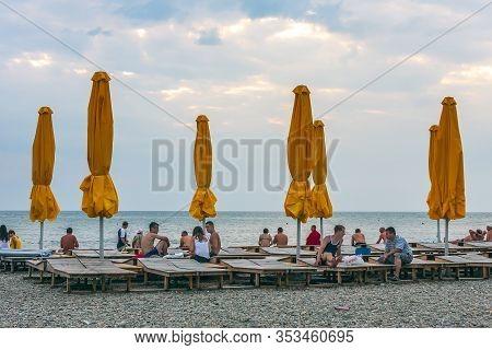 Anapa, Russia - July 26, 2017: Malaya Bay In Anapa Resort. People Rest On Stony Beach Of Black Sea.