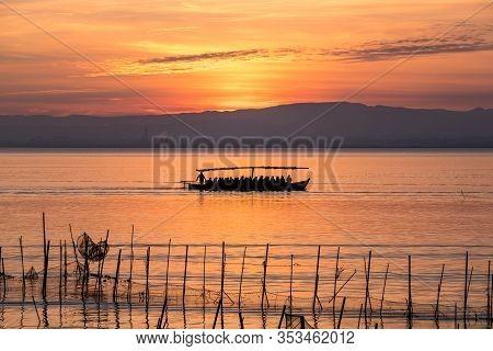 Sunset Pier Albufera Valencia Tourist Ride Boat Reflections Orange Sky In The Lake Naural Park Spain