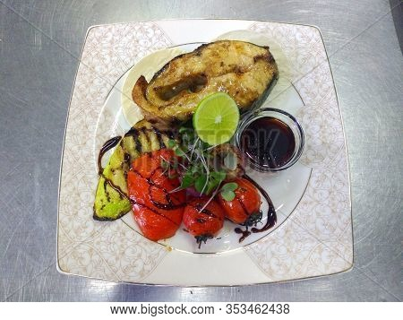 Sturgeon Steak, Grilled Vegetables And Pomegranate Sauce. Sturgeon, Grilled Vegetables, Zucchini, To