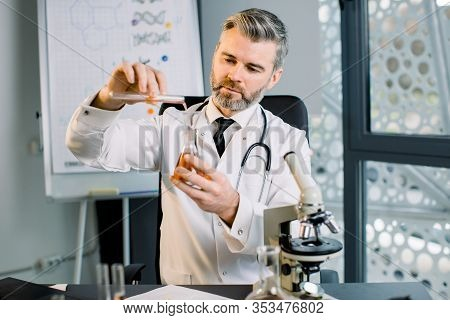 Caucasian Man Virologist, Bio Chemist, Scientist Wearing White Coat Holding Test Tube And Dropped Re