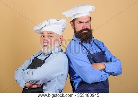 Cafe Workers. Culinary Industry. Restaurant Staff. Culinary Battle. Mature Bearded Men Professional