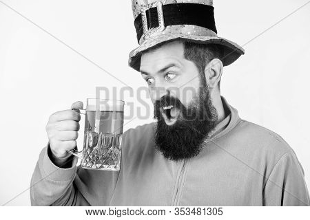 Celebrating Saint Patricks Day In Bar. Irish Man With Beard Drinking Green Beer. Hipster In Leprecha