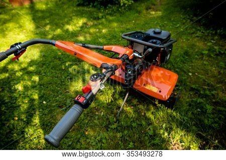Garden With Tiller Machine. Garden Tiller To Work, Close Up.abstract And Conceptual Of Motor Hoe At