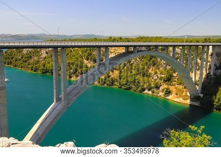 Reinforced Concrete Automobile Long High Arched Bridge Over The Krka River In Croatia Near Sibenik.