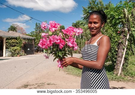 Dominican People. Dominican People Woman With Flowers. Dominican Republic Hato Mayor Province 04.02.